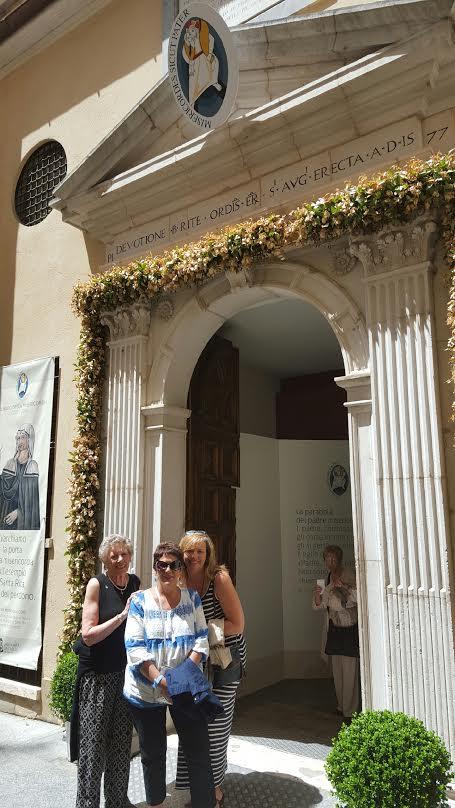 walking-through-the-holy-doors-of-st-rita-s-church