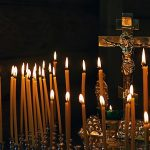 Crucifix surrounded by candles, Photo by ju_see/Shutterstock.
