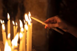 Lighting a candle in church